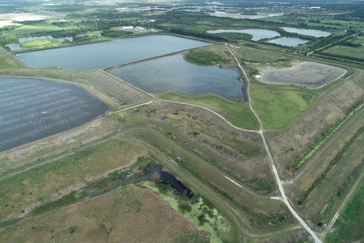 A reservoir of an old phosphate plant was recently found leaking, igniting fears that it may suddenly collapse and flood the